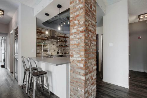 Brick-pillar-kitchen-503-820-15-Avenue-SW-Calgary-Condo-Newbury-Beltline-Mount-Royal-Penthouse-For-Sale-Plintz-Real-Estate