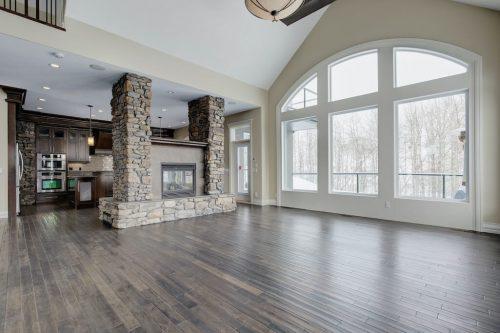 Dual-sided-stone-fireplace-hardwood-8-Villosa-Ridge-Drive-Springbank-Calgary-Alberta-Plintz-Real-Estate-For-Sale-Realtor