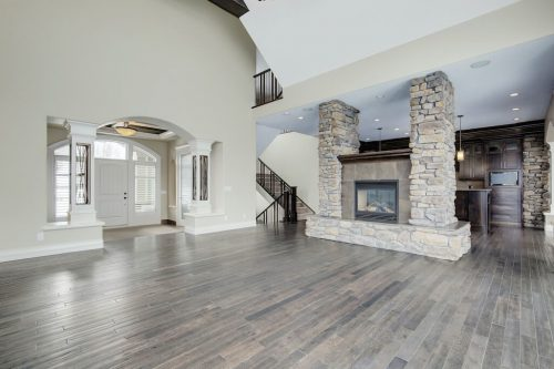 Vaulted ceilings and stone accented fireplace in Calgary home for sale.