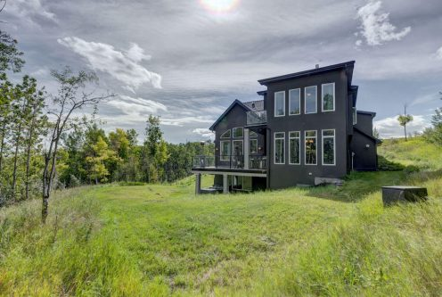 Luxury acreage walkout home surrounded by rolling hills and trees. 8 Villosa Ridge Drive Springbank Calgary