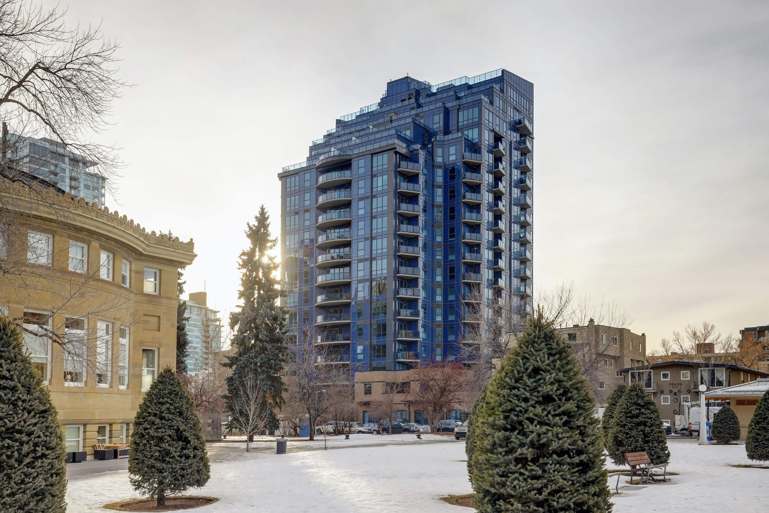 Modern glass condominium tower in Calgary Beltline community. Condo for sale by Plintz Real Estate.