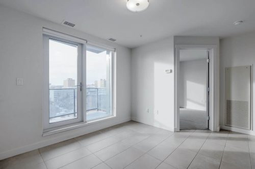 Living area and balcony of condo in The Park condominium tower for sale by Plintz Real Estate