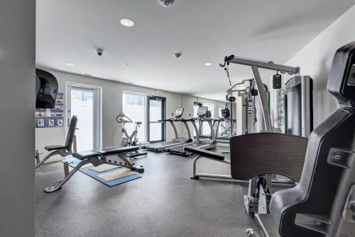 Gym with treadmills and weight equipment at The Park condo building in Calgary Beltline