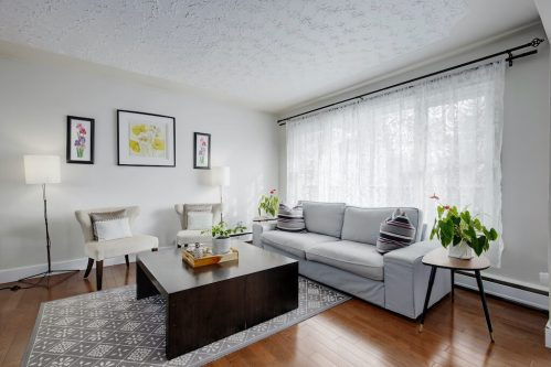 Living-room-couch-window-staging-1320-87-Avenue-SW-Haysboro-Bungalow-For-Sale-Plintz-Real-Estate-Calgary-Realtor