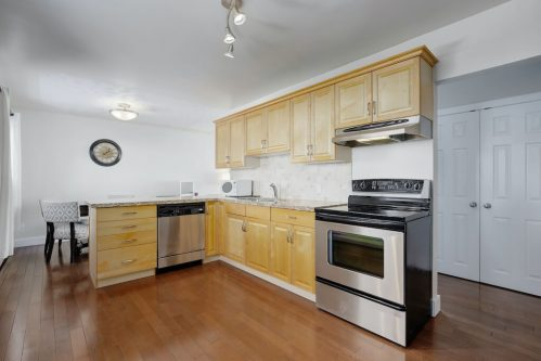 Kitchen-stainless-steel-appliances-1320-87-Avenue-SW-Haysboro-Bungalow-For-Sale-Plintz-Real-Estate-Calgary-Realtor