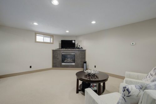 Basement-fireplace-1320-87-Avenue-SW-Haysboro-Bungalow-For-Sale-Plintz-Real-Estate-Calgary-Realtor