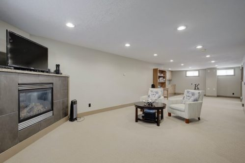 corner-fireplace-rec-room-1320-87-Avenue-SW-Haysboro-Bungalow-For-Sale-Plintz-Real-Estate-Calgary-Realtor