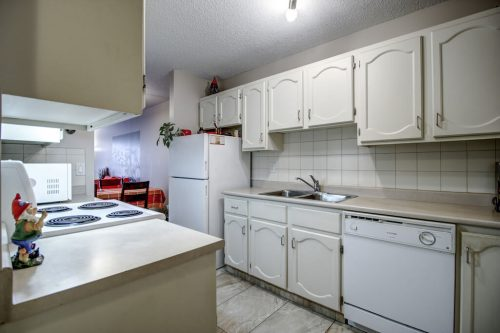 white-cabinets-kitchen-205-611-67-Avenue-SW-Kings-Point-Condo-For-Sale-Plintz-Real-Estate-Kingsland-Calgary-Realtor