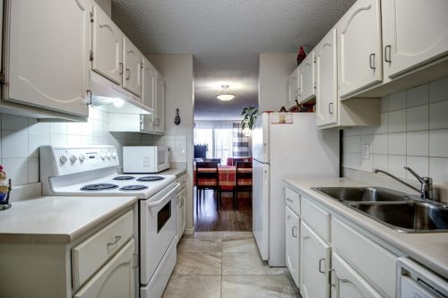 Galley-kitchen-205-611-67-Avenue-SW-Kings-Point-Condo-For-Sale-Plintz-Real-Estate-Kingsland-Calgary-Realtor