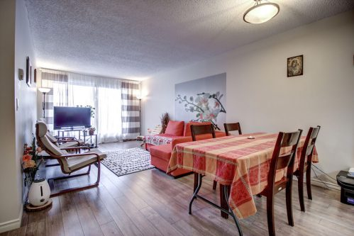living-dining-205-611-67-Avenue-SW-Kings-Point-Condo-For-Sale-Plintz-Real-Estate-Kingsland-Calgary-Realtor