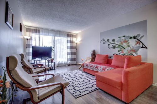 living-room-205-611-67-Avenue-SW-Kings-Point-Condo-For-Sale-Plintz-Real-Estate-Kingsland-Calgary-Realtor