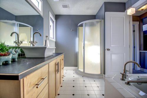 bathroom-corner-tub-shower-bowl-sink-2503-16-Street-SW-Bankview-Calgary-Real-Estate-Homes-For-Sale-Plintz-Realtor-Dennis-Inner-City