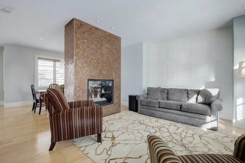 licing-room-tile-two-sided-fireplace-3119-Kilkenny-Drive-SW-Killarney-Calgary-Real-Estate-Homes-For-Sale-Plintz-Realtor-Dennis