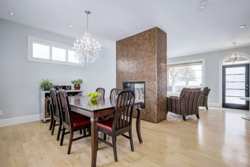 two-sided-fireplace-tile-dining-front-door-hardwood-floors-3119-Kilkenny-Drive-SW-Killarney-Calgary-Real-Estate-Homes-For-Sale-Plintz-Realtor-Dennis