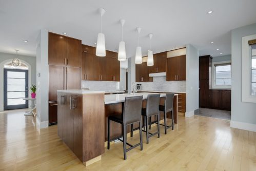 Kitchen-island-pendant-island-dack-cabinetry-chocolate-3119-Kilkenny-Drive-SW-Killarney-Calgary-Real-Estate-Homes-For-Sale-Plintz-Realtor-Dennis