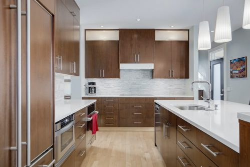 Kitchen-island-pendant-lighting-quartz-countertops-luxury-3119-Kilkenny-Drive-SW-Killarney-Calgary-Real-Estate-Homes-For-Sale-Plintz-Realtor-Dennis
