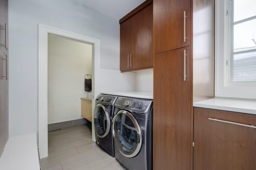 laundry-room-front-loading-washer-dryer-3119-Kilkenny-Drive-SW-Killarney-Calgary-Real-Estate-Homes-For-Sale-Plintz-Realtor-Dennis
