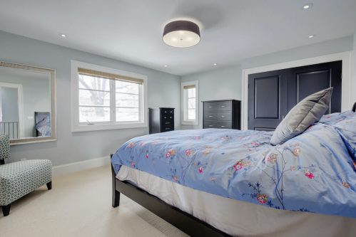 drum-light-master-bedroom-blue-blanket-3119-Kilkenny-Drive-SW-Killarney-Calgary-Real-Estate-Homes-For-Sale-Plintz-Realtor-Dennis