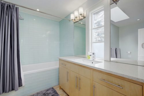 bathroom-tile-bathroom-granite-vanity-3119-Kilkenny-Drive-SW-Killarney-Calgary-Real-Estate-Homes-For-Sale-Plintz-Realtor-Dennis