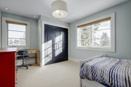 bedroom-stripe-blanket-desk-3119-Kilkenny-Drive-SW-Killarney-Calgary-Real-Estate-Homes-For-Sale-Plintz-Realtor-Dennis