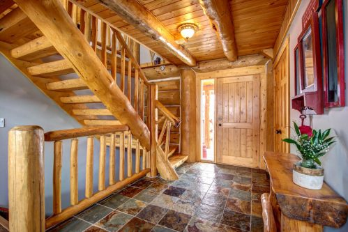 entry-foyer-timber-railing-beam-staircase-107-Signal-Hill-Point-SW-Home-For-Sale-Plintz-Real-Estate-Walkout-Basement-Realtor-Dennis