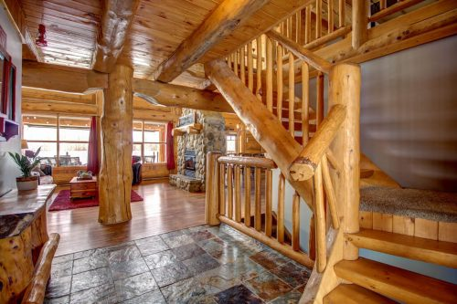 timber-staircase-slate-tile-hardwood-107-Signal-Hill-Point-SW-Home-For-Sale-Plintz-Real-Estate-Walkout-Basement-Realtor-Dennis