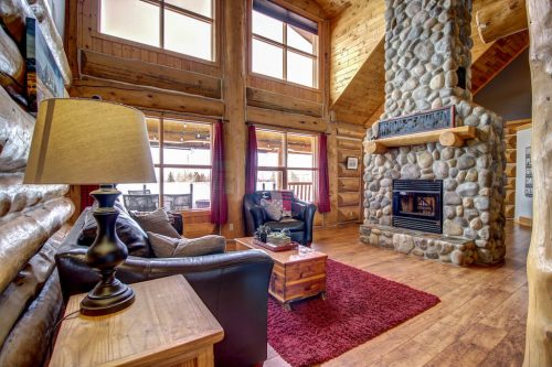 two-storey-great-room-stone-fireplace-hardwood-windows-107-Signal-Hill-Point-SW-Home-For-Sale-Plintz-Real-Estate-Walkout-Basement-Realtor-Dennis