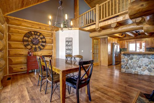 dining-room-chandelier-hardwood-timber-stone-vaulted-107-Signal-Hill-Point-SW-Home-For-Sale-Plintz-Real-Estate-Walkout-Basement-Realtor-Dennis