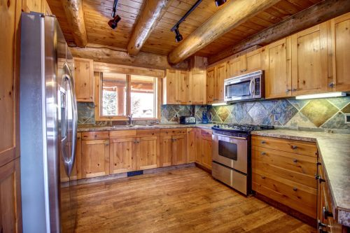 open-beam-timber-frame-kitchen-107-Signal-Hill-Point-SW-Home-For-Sale-Plintz-Real-Estate-Walkout-Basement-Realtor-Dennis
