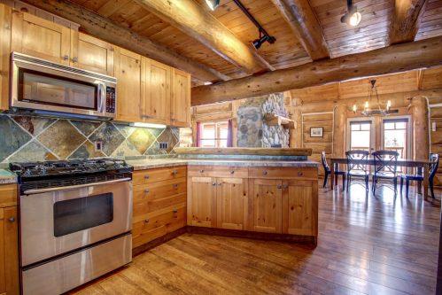 kitchen-gas-range-hardwood-floor-timber-beam-107-Signal-Hill-Point-SW-Home-For-Sale-Plintz-Real-Estate-Walkout-Basement-Realtor-Dennis