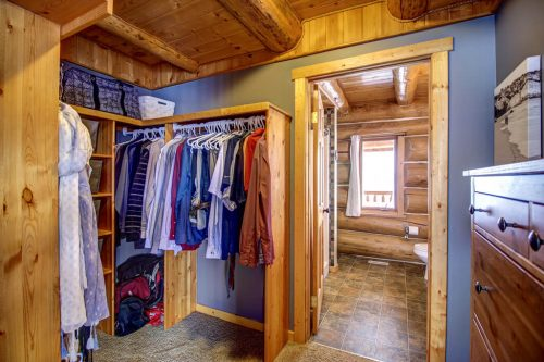 walk-in-closet-timber-beam-107-Signal-Hill-Point-SW-Home-For-Sale-Plintz-Real-Estate-Walkout-Basement-Realtor-Dennis