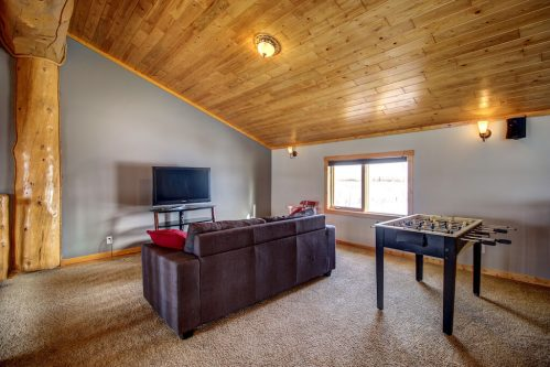 vaulted-wood-plack-ceiling-fooseball-107-Signal-Hill-Point-SW-Home-For-Sale-Plintz-Real-Estate-Walkout-Basement-Realtor-Dennis