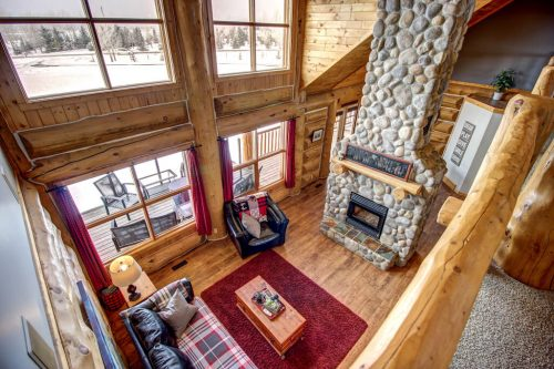 Two-storey-stone-fireplace-great-room-timber-hardwood-windows-107-Signal-Hill-Point-SW-Home-For-Sale-Plintz-Real-Estate-Walkout-Basement-Realtor-Dennis