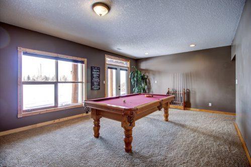 walkout-basement-pool-table-billards-107-Signal-Hill-Point-SW-Home-For-Sale-Plintz-Real-Estate-Walkout-Basement-Realtor-Dennis