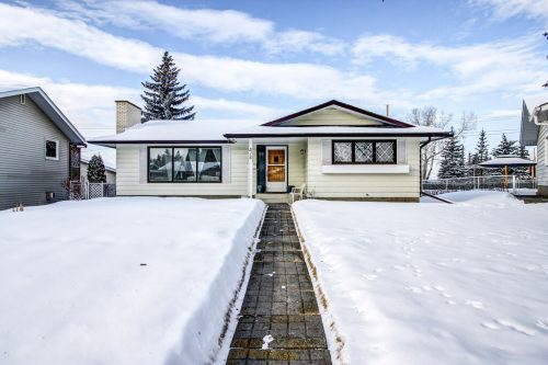 Bungalow with blue sky and deep snow in Willow Park Calgary. Home for sale by Plintz Real Estate