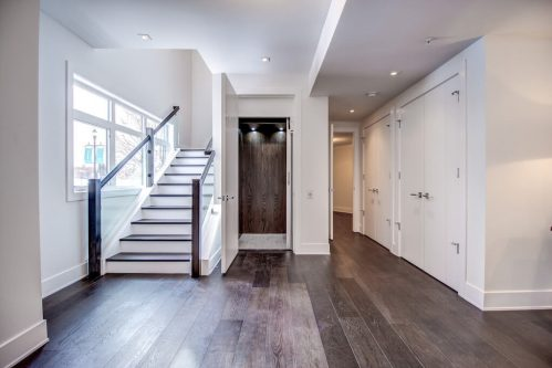 Foyer-Elevator-Staircase-8-Victoria-Cross-Boulevard-SW-Empire-Custom-Homes-Townhouse-For-Sale-Plintz-Real-Estate-Calgary-Currie-Barracks-Realtor-Dennis
