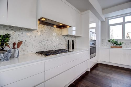 Backsplash-Luxury-cabinetry-white-8-Victoria-Cross-Boulevard-SW-Empire-Custom-Homes-Townhouse-For-Sale-Plintz-Real-Estate-Calgary-Currie-Barracks-Realtor-Dennis