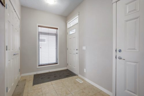 Entrance-white-doors-tile-218-Kincora-Glen-Rise-NW-Calgary-Real-Estate-For-Sale-Plintz-Realtor-Realty-Walkout
