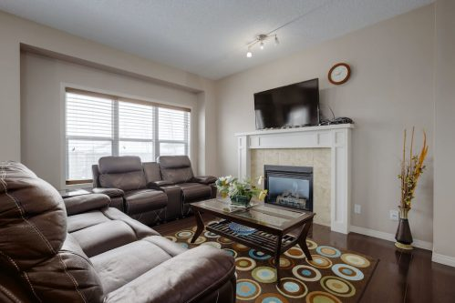 living-room-fireplace-mantel-218-Kincora-Glen-Rise-NW-Calgary-Real-Estate-For-Sale-Plintz-Realtor-Realty-Walkout