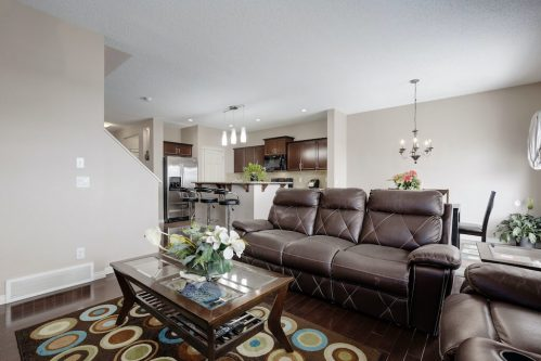 living-room-leather-sofa-218-Kincora-Glen-Rise-NW-Calgary-Real-Estate-For-Sale-Plintz-Realtor-Realty-Walkout