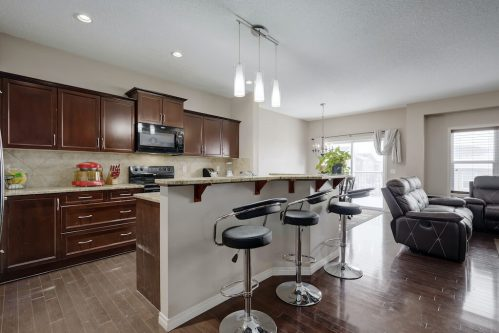 Kitchen-island-open-concept-218-Kincora-Glen-Rise-NW-Calgary-Real-Estate-For-Sale-Plintz-Realtor-Realty-Walkout