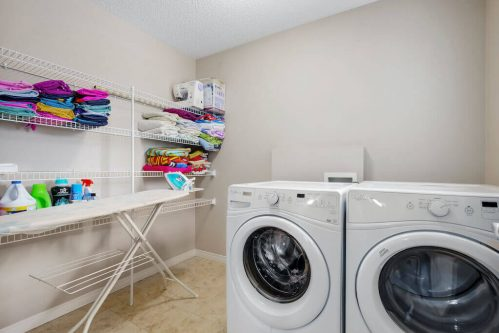 laundry-room-front-loading-washer-dryer-218-Kincora-Glen-Rise-NW-Calgary-Real-Estate-For-Sale-Plintz-Realtor-Realty-Walkout