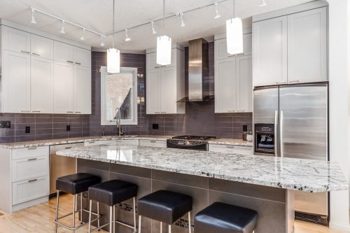 luxury-kitchen-granite-island-black-stools-white-cabinetry-47-28-Avenue-SW-Erlton-Calgary-Home-For-Sale-Plintz-Real-Estate-House-realtor-realty