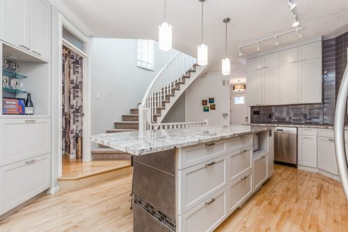 White-kitchen-island-granite-cureved-staircase-47-28-Avenue-SW-Erlton-Calgary-Home-For-Sale-Plintz-Real-Estate-House-realtor-realty