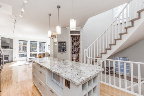 open-concept-white-kitchen-47-28-Avenue-SW-Erlton-Calgary-Home-For-Sale-Plintz-Real-Estate-House-realtor-realty-staircase