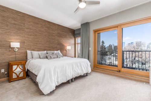 Master-bedroom-textured-feature-wall-city-views-balcony-47-28-Avenue-SW-Erlton-Calgary-Home-For-Sale-Plintz-Real-Estate-House-realtor-realty