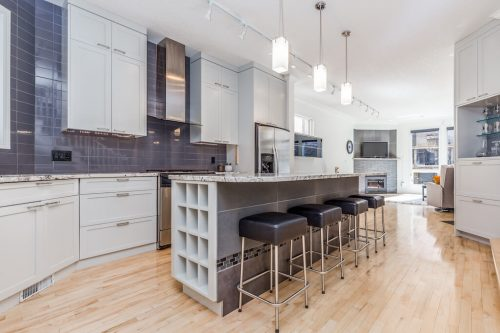 Kitchen-wine-rack-island-pendant-lighting-tile-backsplash-47-28-Avenue-SW-Erlton-Calgary-Home-For-Sale-Plintz-Real-Estate-House-realtor-realty