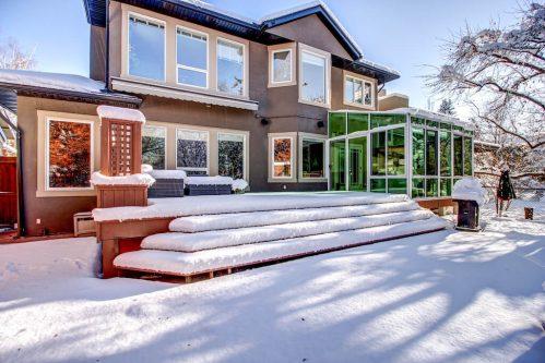 Backyard-winter-sunroom-deck-backyard-818-Rideau-Road-SW-Calgary-Real-Estate-For-Sale-Luxury-Home-Plintz-Realtor-Realty