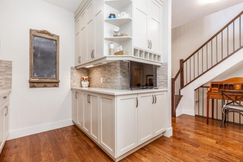 pantry-white-cabinetry-tile-backsplash-3514-42-Street-SW-Glenbrook-Calgary-Home-Real-Estate-for-sale-infill-attached-Plintz
