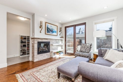 living-room-marble-fireplace-floating-shelves-3514-42-Street-SW-Glenbrook-Calgary-Home-Real-Estate-for-sale-infill-attached-Plintz